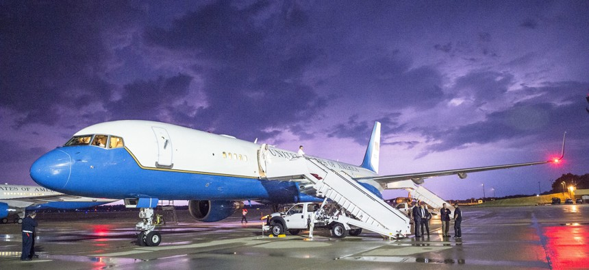 Lightning illuminates the sky behind a military C-32A (Boeing 757) parked on Joint Base Andrews, Md., May 18, 2015.