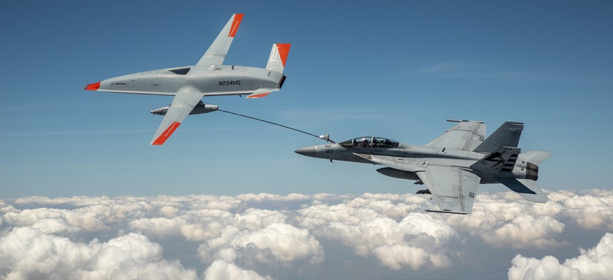 The Boeing MQ-25 T1 sends fuel to a U.S. Navy F/A-18 Super Hornet during a June 4 test flight, the first time an unmanned aircraft has refueled another aircraft.