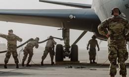 Airmen connect a fuel host to a U.S. Air Force KC-135 Stratotanker aircraft at Doha Air Base, Qatar, Jan. 21, 2021.
