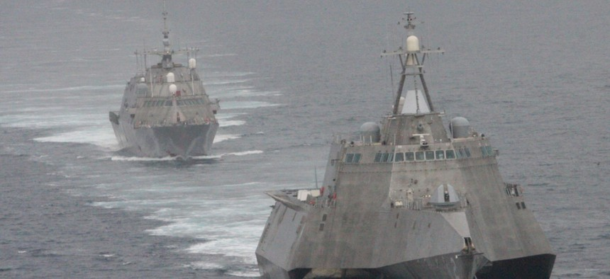 The first of class littoral combat ships USS Freedom and USS Independence maneuver together during an exercise off the coast of Southern California in May 2012.