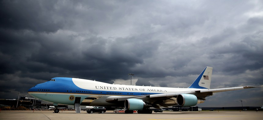 Dark clouds are seen behind the Air Force One on the tarmac at the airport Langenhagen near Hanover, central Germany, on April 25, 2016.