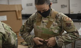 Tech. Sgt. Emily Souza, 23d Security Forces Squadron NCO in charge of combat arms, adjusts body armor Nov. 20, 2020, at Moody Air Force Base, Georgia.
