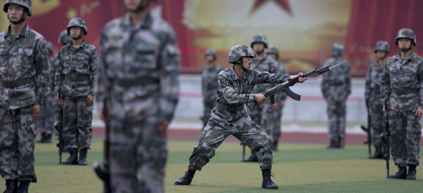 Chinese People's Liberation Army cadets drill at the Armoured Forces Engineering Academy Base in 2014.