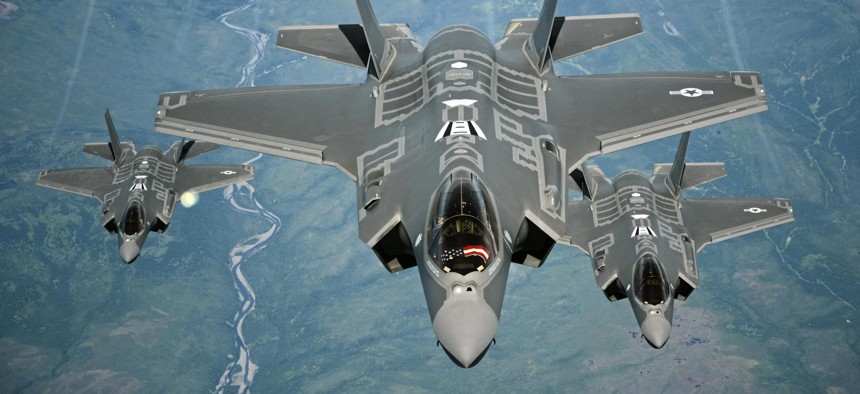 F-35A Lightning II aircraft receive fuel from a KC-10 Extender tanker aircraft from Travis Air Force Base, Calif., during a flight from England to the United States, July 13, 2016.