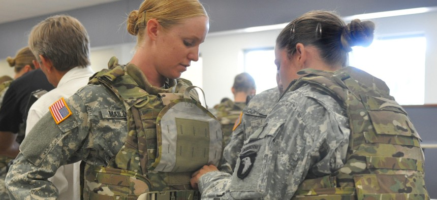 How long has the Army been working on body armor for its women? Soldiers try on prototype vests at Fort Campbell — in 2012.