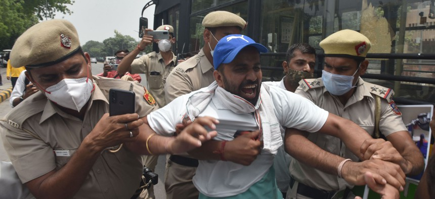 Delhi Police detained Indian Youth Congress (IYC) party activists in New Dehli on June 11, 2021.