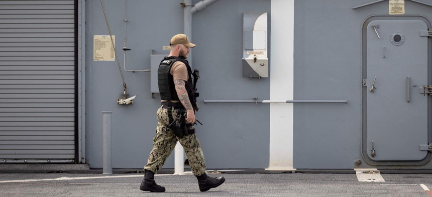 """A member of the US Navy walks at the US navy's ship """"Hershel Woody Williams"""" during the """"African Lion"""" military exercise, on June 11, 2021, in Morocco's city of Agadir."""