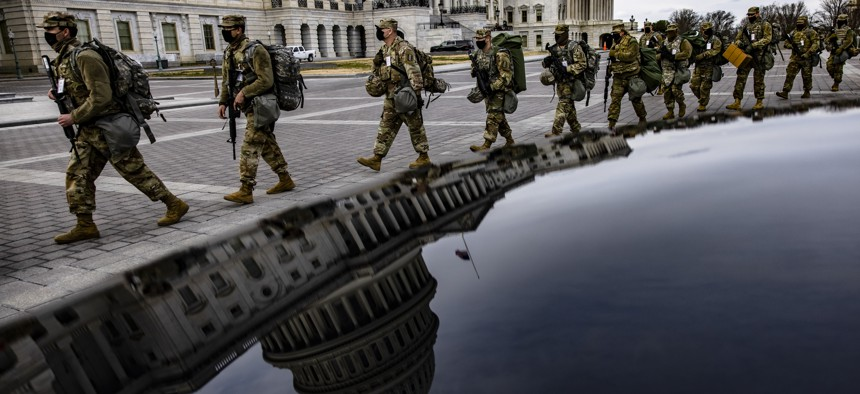 Virginia National Guard soldiers march across the U.S. Capitol on their way to their guard posts on January 16, 2021, in Washington, DC.