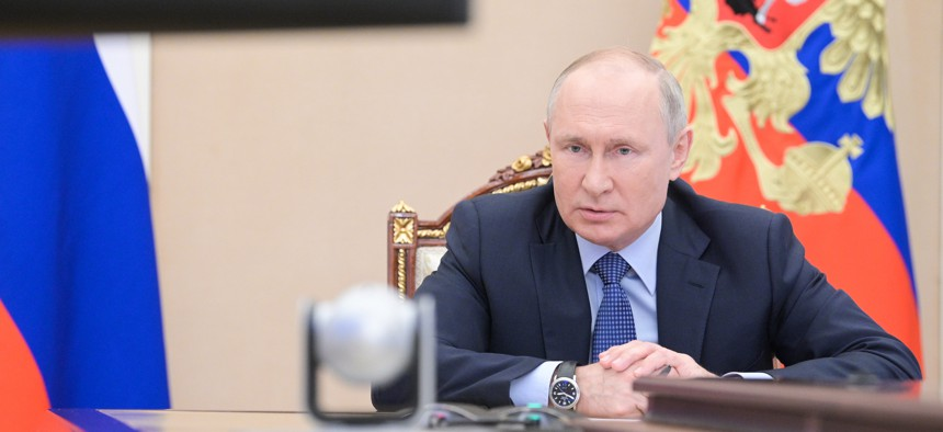 Russia's President Vladimir Putin meets with graduates of the Management Personnel Pool programme of the Graduate School of Public Administration at the Russian Presidential Academy of National Economy and Public Administration (RANEPA), via a video linkup from the Moscow Kremlin on June 17, 2021.