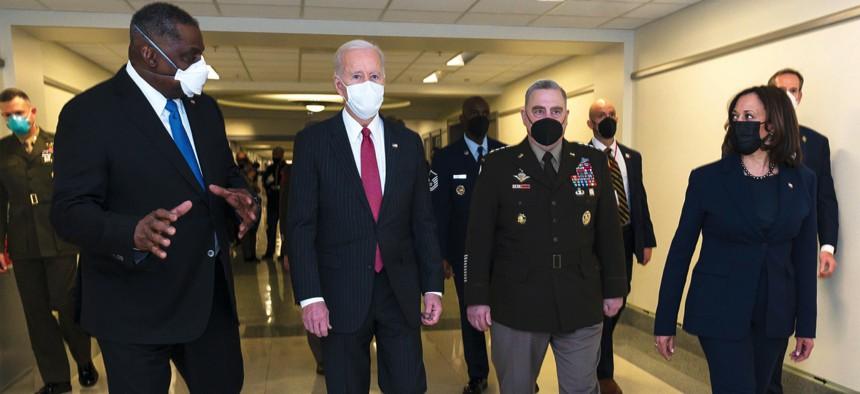 President Joe Biden walks with Defense Secretary Lloyd J. Austin III, left, Army Gen. Mark A. Milley, chairman of the Joint Chiefs of Staff, and Vice President Kamala Harris at the Pentagon on Feb. 10.