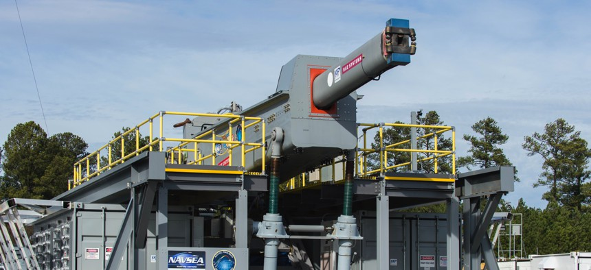 A 2017 photo of the Office of Naval Research's Electromagnetic Railgun on a range at Naval Surface Warfare Center Dahlgren Division.