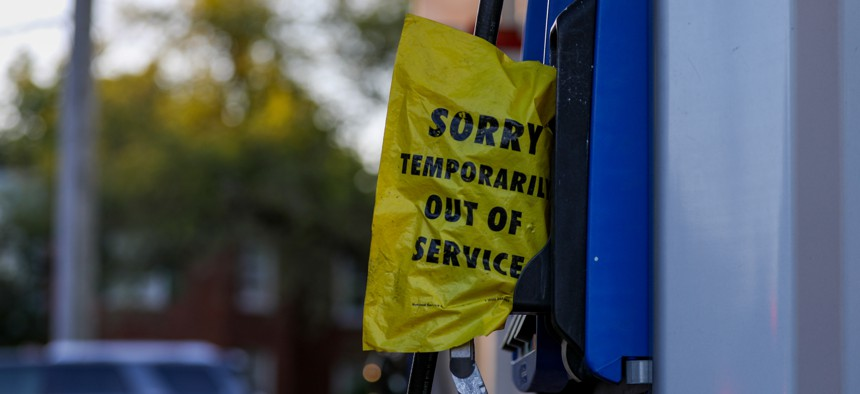 """A """"Temporarily Out of Service"""" sign is seen on a gas pump after a ransomware cyberattack causes Colonial Pipeline to shut down, resulting in gas shortages in Washington D.C, on May 12, 2021."""