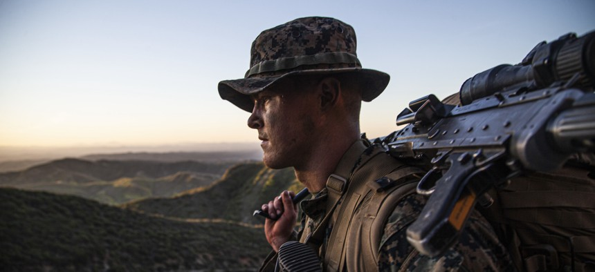 U.S. Marine Pfc. Nathaniel Haefling carries an M240 medium machine gun during a five-day capstone exercise for the Infantry Marine Course on Marine Corps Base Camp Pendleton, California, April 30, 2021.