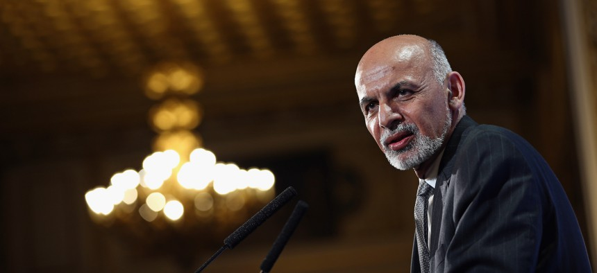 Afghanistan's President Ashraf Ghani speaks to delegates and ministers during the London Conference on Afghanistan on December 4, 2014.