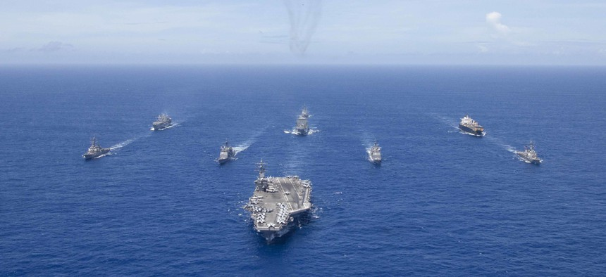 USS Ronald Reagan (CVN 76) leads a formation of Carrier Strike Group 5 ships during Valiant Shield 2018.
