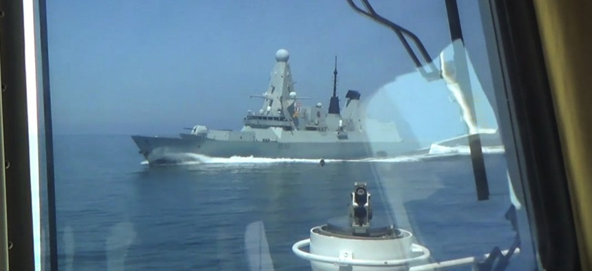 A photo provided by Russian state media shows how close a Russian vessel came to HMS Defender on June 23.
