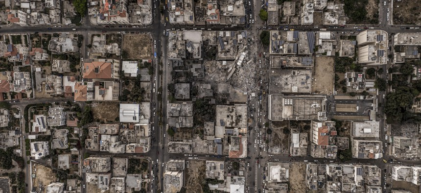 A drone views of the ruins of buildings in Gaza city that was levelled by an Israeli air strike during the recent military conflict between Israel and Palestinian ruled by Hamas on June 11, 2021.