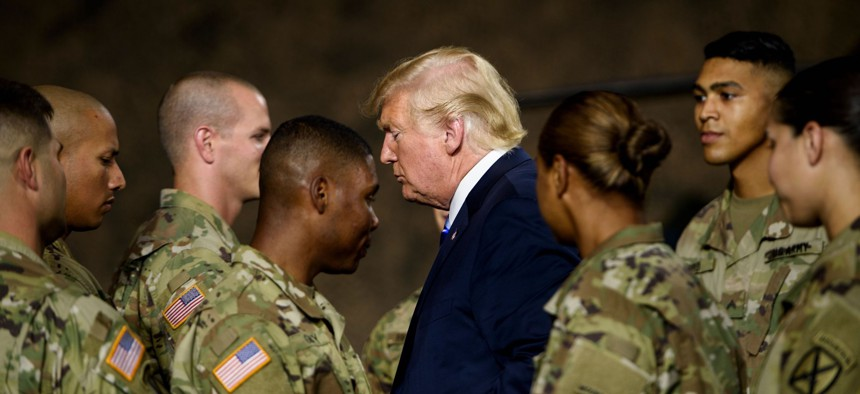 US President Donald Trump leaves after signing the John S. McCain National Defense Authorization Act for Fiscal Year 2019 at Fort Drum, New York, on August 13, 2018.