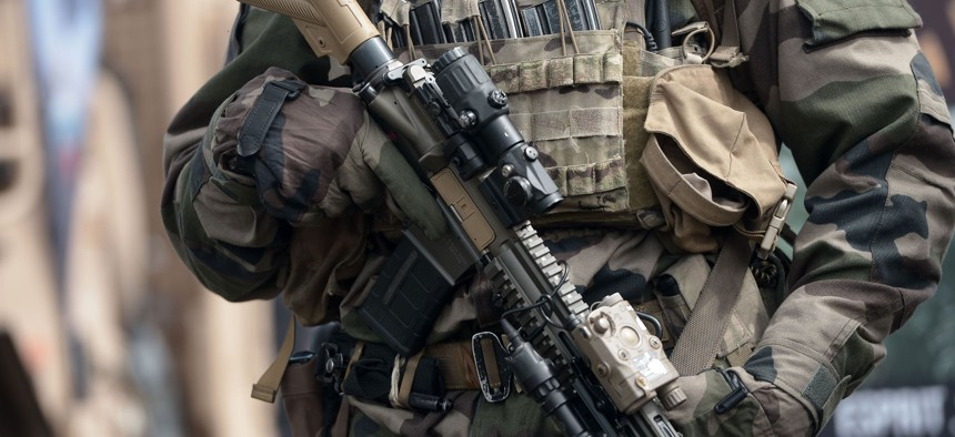 A member of French army 4th Special Forces Helicopter Regiment (4th RHFS) holds a German made assault rifle HK416 which will replace the French Famas assault rifle, on June 13, 2019 in Pau, southwestern France.