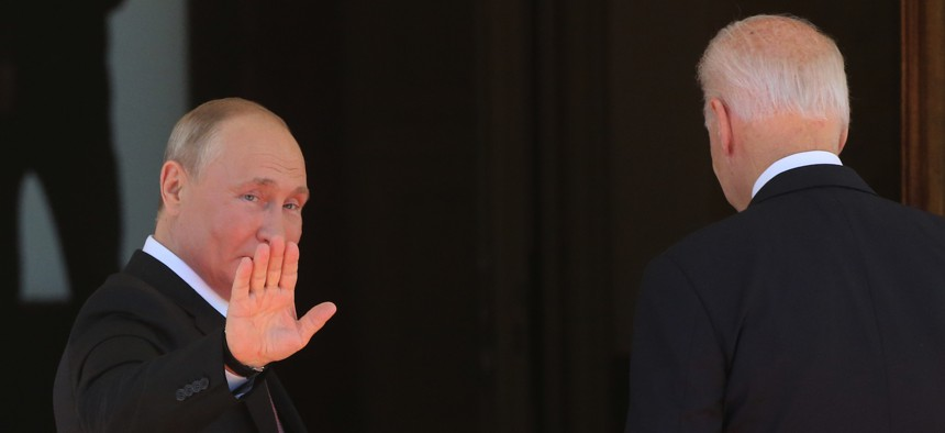Russian President Vladimir Putin (L) greets President of USA Joe Biden (R) during the US - Russia Summit 2021 at the La Grange Villa near the Geneva Lake, on June 16, 2021 in Geneva, Switzerland.