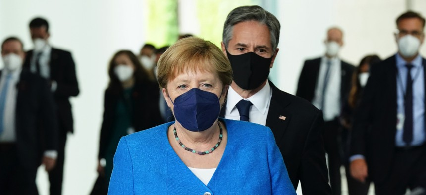 German Chancellor Angela Merkel and U.S. Secretary of State Antony Blinken arrive for a joint press conference in Berlin on June 23, 2021.