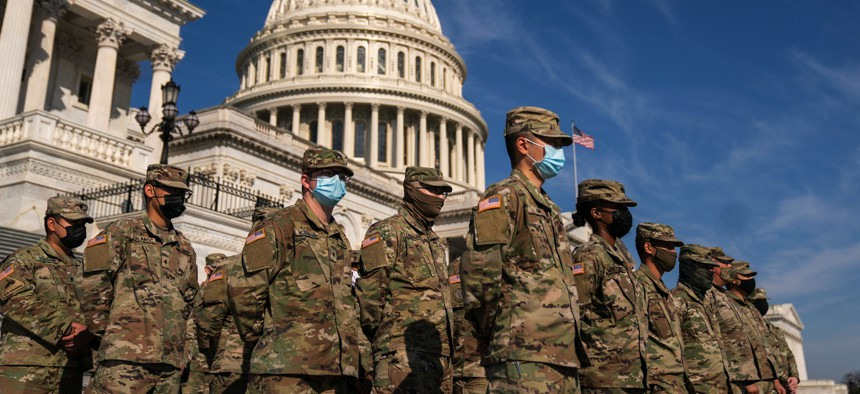 Members of the National Guard from California on the steps of the House, on Capitol Hill on March 11, 2021.