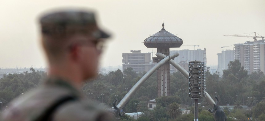 A U.S. Army soldier looks onto Baghdad and the Saddam-era Crossed Sabers monument from the International Zone on May 30, 2021.