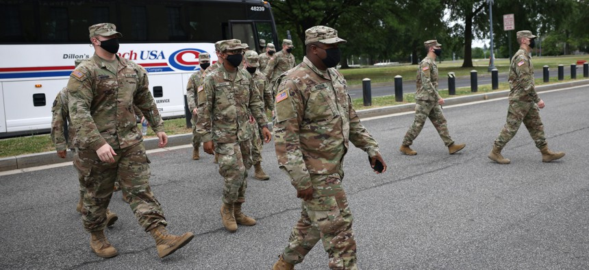 National Guard troops arrive at the DC Armory on May 24, 2021, after ending their mission of providing security to the U.S. Capitol.