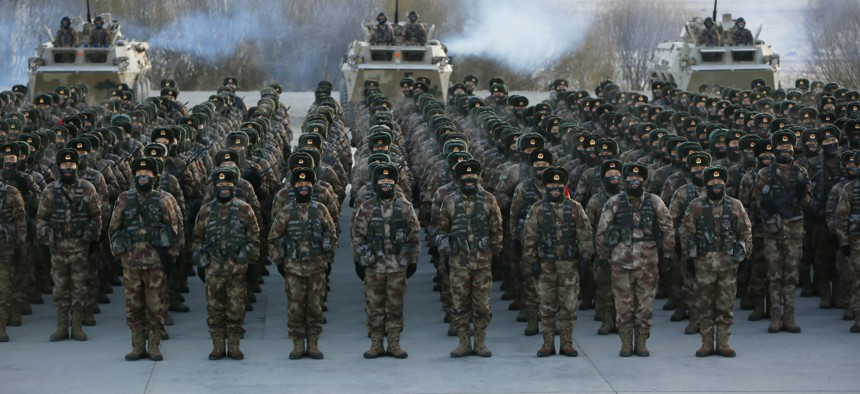 Chinese People's Liberation Army (PLA) soldiers assembling during military training at Pamir Mountains in Kashgar, northwestern China's Xinjiang region on January 4, 2021.