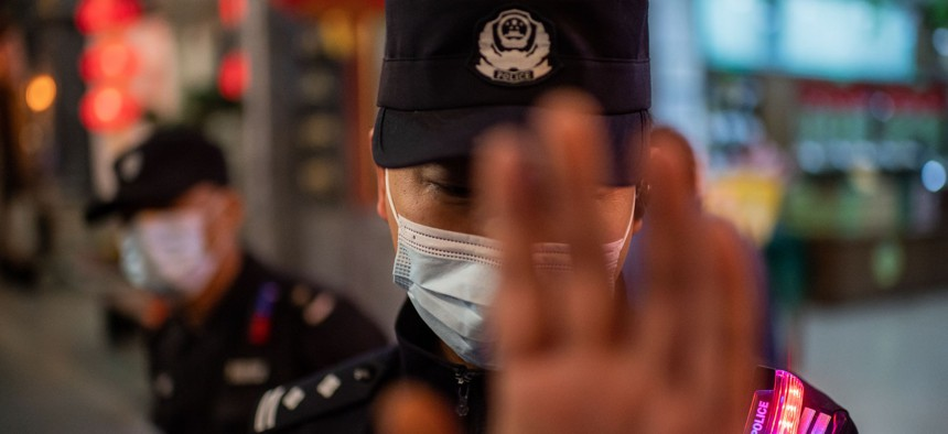 A police officer wearing a face mask in Beijing.