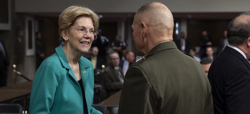 Sen. Elizabeth Warren, D-Mass., greets Gen. Robert B. Neller, then the commandant of the Marine Corps, prior to a Senate Armed Services Committee on April 9, 2019.