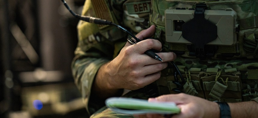 U.S. Air Force Capt. Theodore Bertsch makes radio communications inside the Joint Terminal Attack Controller battlefield dome simulator on Einsiedlerhof Air Station, Germany, June 23, 2021.