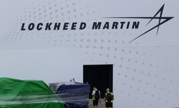 A man looks at the container goods sitting outside the Lockheed Martin booth during the Singapore Airshow media preview on February 9, 2020 in Singapore.