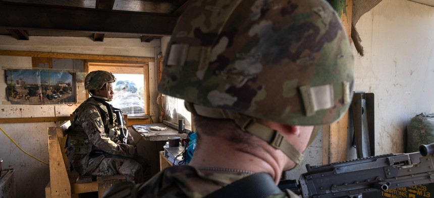 U.S. Army soldiers look onto Baghdad from a guardhouse on the perimeter of the International Zone on May 30, 2021 in Baghdad, Iraq.