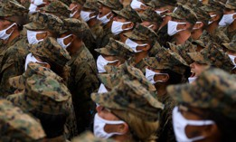 United States Marine Corps recruits wear face masks as they sing The Marines' Hymn on April 22, 2021, at Camp Pendleton, California.