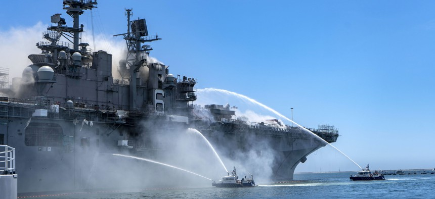 Port of San Diego Harbor Police Department boats fight a fire aboard the amphibious assault ship USS Bonhomme Richard at Naval Base San Diego, July 12, 2020.