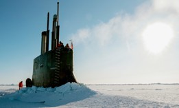 The Seawolf-class fast-attack submarine USS Connecticut surfaces through the ice in the Beaufort Sea as it participates in Ice Exercise 2018.