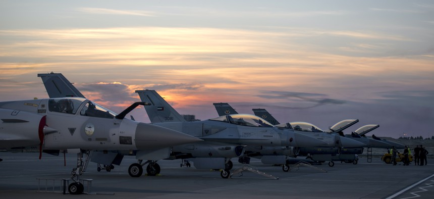 U.S. Air Force and UAE F-16 Fighting Falcons stand on display at Sakhir Air Base during the Bahrain International Airshow 2018, Nov. 14, 2018.
