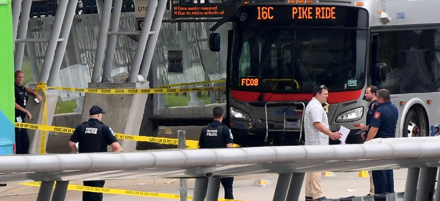 Law enforcement officers are seen at the metro bus platform outside the Pentagon after a shooting and lockdown August 3, 2021.