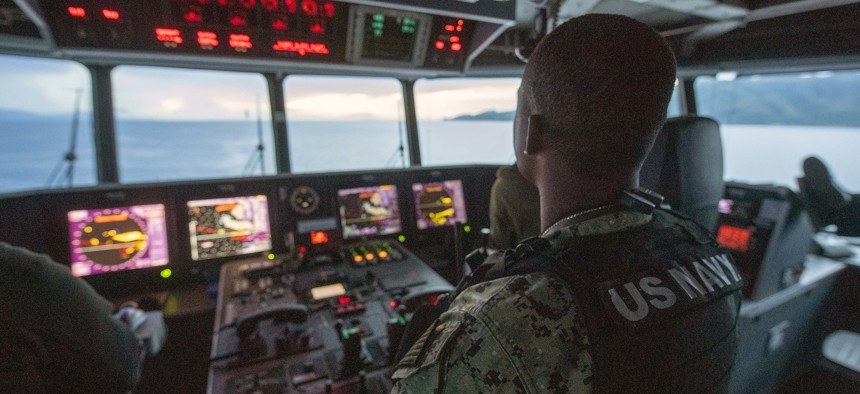 Chief Master-at-Arms Cornelius Johnson stands watch on the bridge aboard the Spearhead-class expeditionary fast transport USNS City of Bismarck, during Pacific Partnership 21.