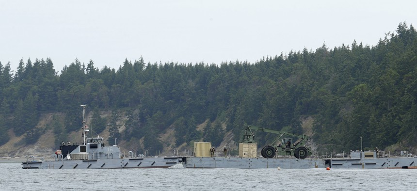 U.S. Navy sailors move a cargo container from a modular barge to shore, Wednesday, June 8, 2016, on Naval Magazine Indian Island in Washington state, as part of a massive earthquake and tsunami drill called Cascadia Rising. The drill is built around the premise of a 9.0 magnitude earthquake 95 miles off of the coast of Oregon that results in a tsunami.