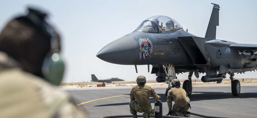 U.S. Airmen from the 26th Expeditionary Rescue Squadron participate in a Forward Area Refueling Point exercise for two F-15E Strike Eagles, August 2, 2021, at an undisclosed location in Southwest Asia.