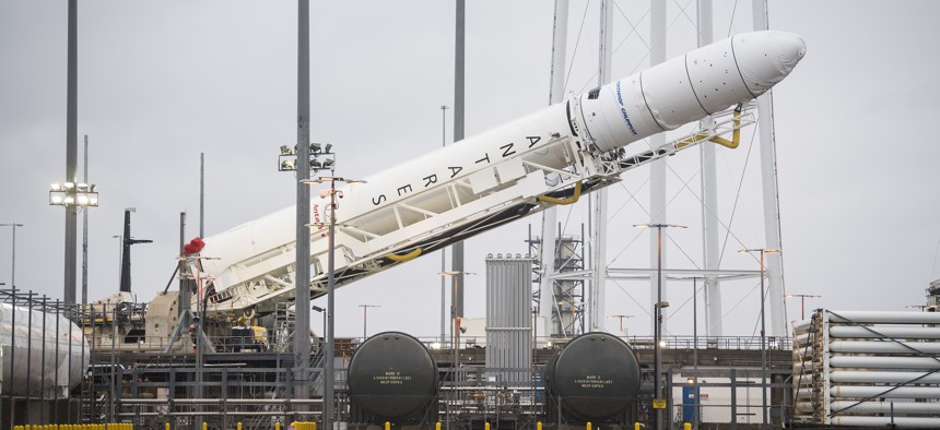 An Antares rocket carrying a Cygnus resupply spacecraft is raised into a vertical position at NASA's Wallops Flight Facility in Virginia, February 5, 2020.