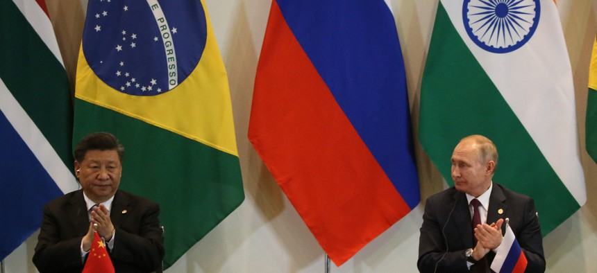 BRASILIA, BRAZIL - NOVEMBER,14 (RUSSIA OUT) Russian President Vladimir Putin (R) and Chinese President Xi Jinping (L) aplaud during the BRICS Summit in Brasilia, Brazil, November 14, 2019. Leaders of Russia, China, Brazil, India and South Africa have gateheres in Brasila for the BRICS Leaders Summit