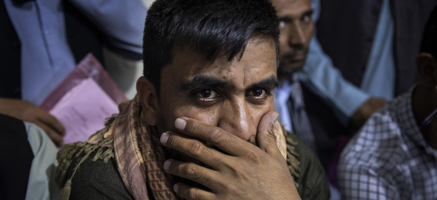 Afghan Special Immigrant Visa applicants crowd into the Herat Kabul Internet cafe to apply for the SIV program on August 8, 2021, in Kabul, Afghanistan.
