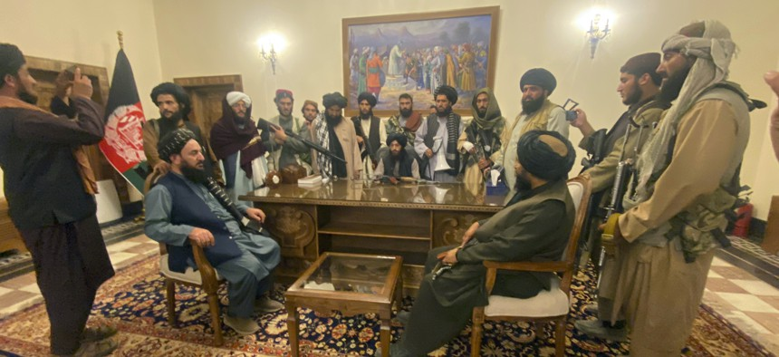 Taliban fighters take control of Afghan presidential palace after the Afghan President Ashraf Ghani fled the country, in Kabul, Afghanistan, Aug. 15, 2021.