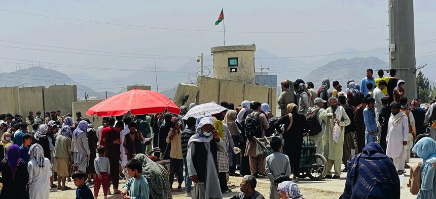 Hundreds of people gather outside the international airport in Kabul, Afghanistan, on Aug. 17, 2021.