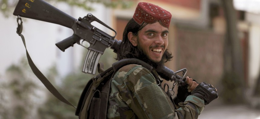 A Taliban fighter patrols in Wazir Akbar Khan in the city of Kabul, Afghanistan, Wednesday, Aug. 18, 2021.