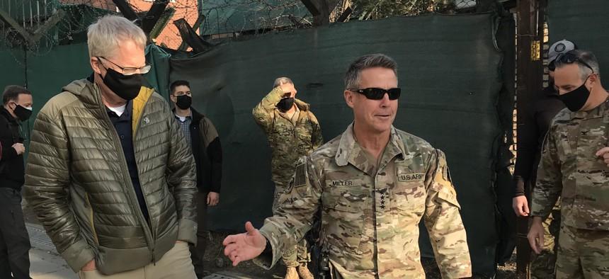 A December 2020 photo shows Acting Defense Secretary Chris Miller, left, with Gen. Austin Scott Miller, the last commander of U.S. forces in Afghanistan.