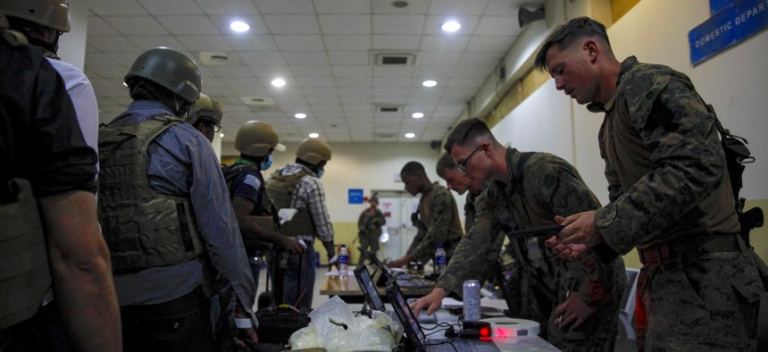 Marines of the 24th Marine Expeditionary Unit process Department of State personnel for evacuation at Hamid Karzai International Airport, Kabul, Afghanistan, August 15.